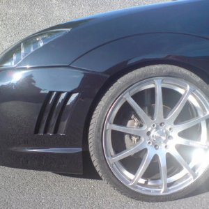 18 inch kunzite alloys wrapped in AVON tyres and lowered 60mm.