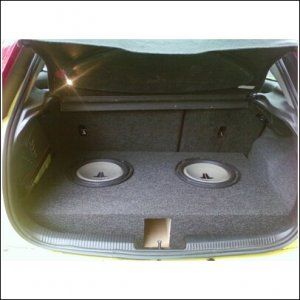 (Sold this setup) I still can fold down my seats with the trunk hatch level to my subwoofer enclosure.