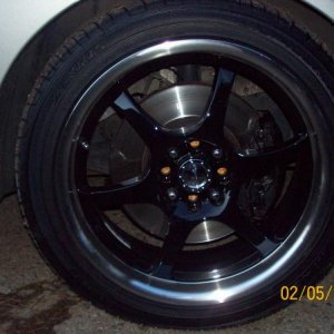 Raceline Black w/ Machined Polished Lip, wrapped Zexius/Ohtsu tires
