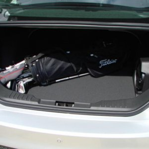 Set of golf clubs fit fine in the back of the sedan.