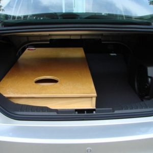 Two corn hole boards fit after lowering the back seat.